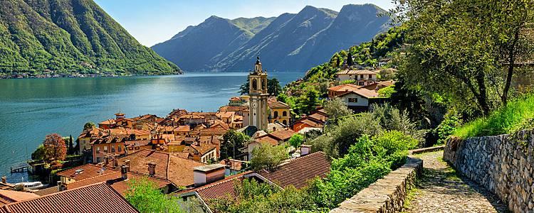 Sendero entre montañas, lagos y vida local