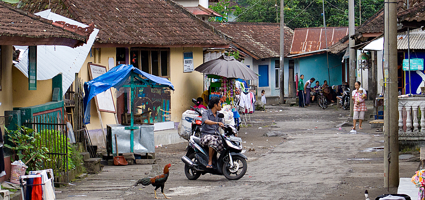 Trip on a motorbike in a small Indonesian village