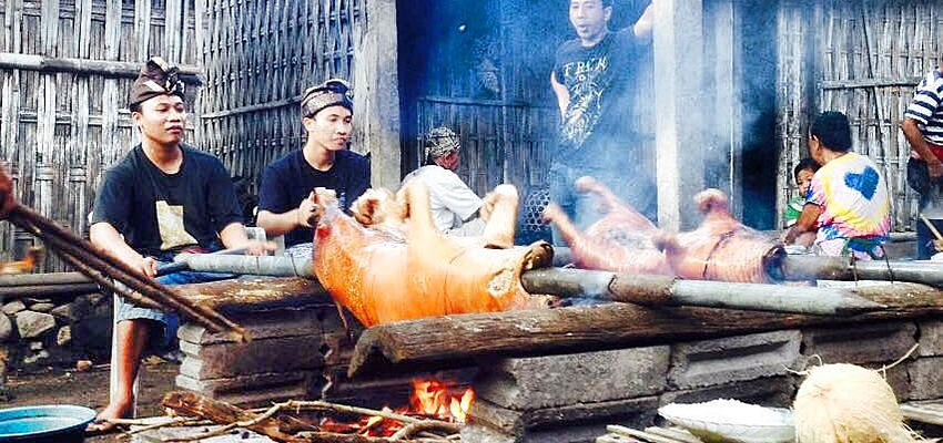 Cooking a babi guling in Amed, Bali